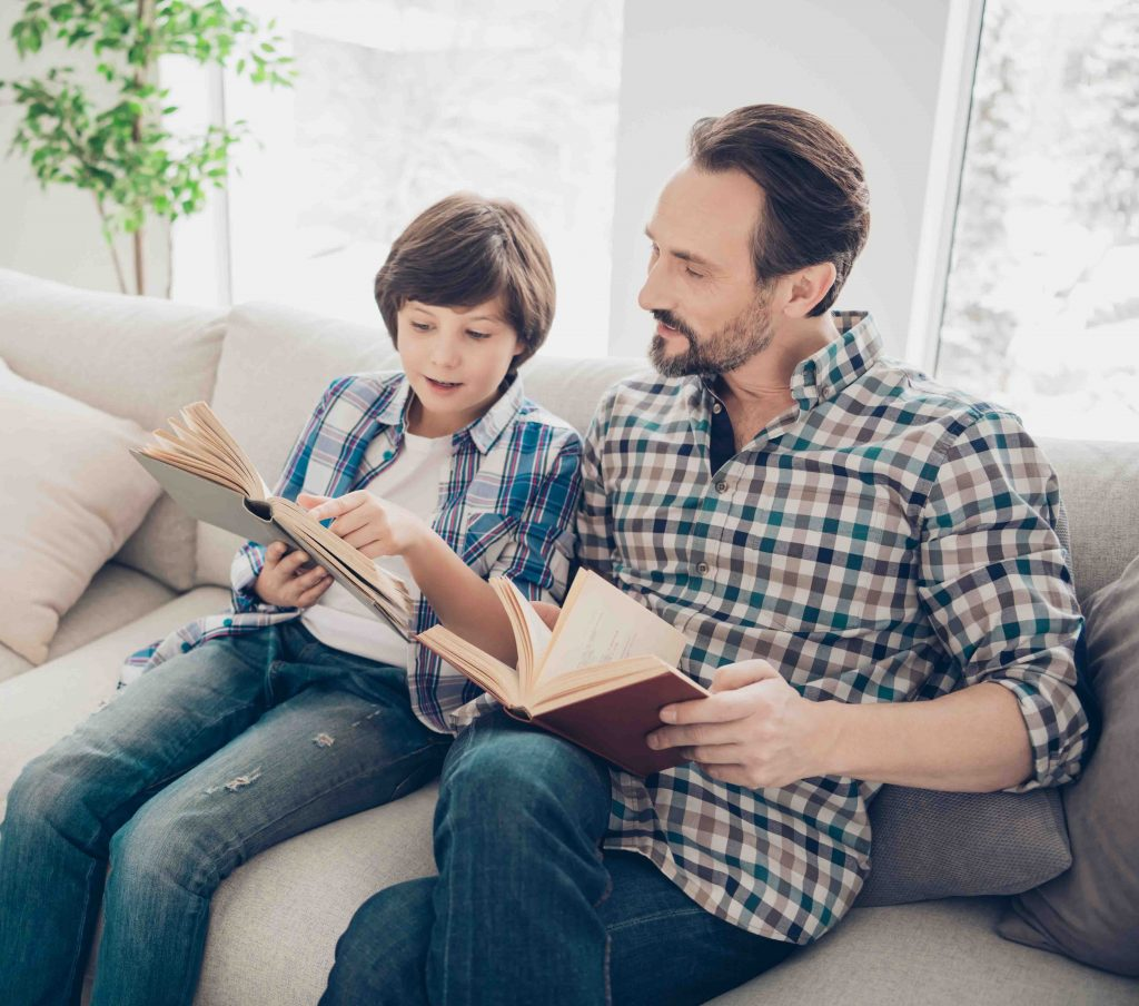 This image has an empty alt attribute; its file name is father-son-reading-different-books-1024x904.jpg